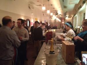 Dinner guests enjoying Krug NV Champagne before dinner